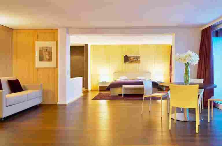 Blick auf den Schlafbereich der Allgäu Sonne Suite