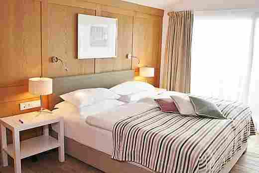 Schlafzimmer in der Alpin Suite im Hotel Allgäu Sonne in Oberstaufen