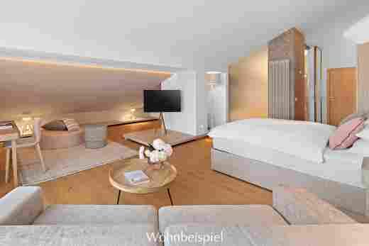 Wohn- und Schlafbereich in einer Juniorsuite im Hotel Allgäu Sonne in Oberstaufen
