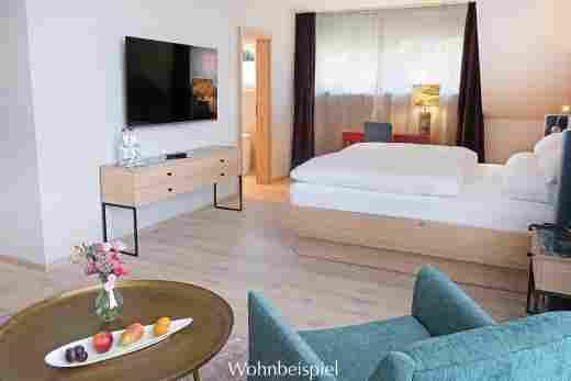 Blick aufs Bett im Studio im Landhaus im Wellnesshotel Allgäu Sonne in Oberstaufen